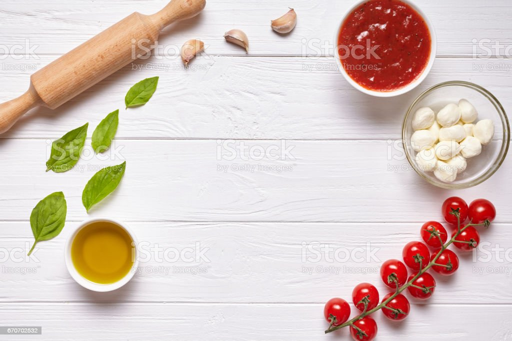 Rustic traditional Italian food background with empty copy design space on white wooden texture kitchen table stock photo