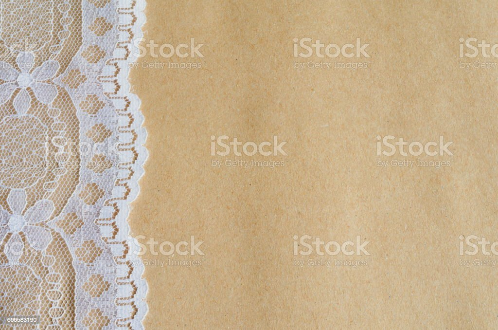 Rustic Vintage White Lace On Craft Parchment Paper Background Royalty Free Stock Photo