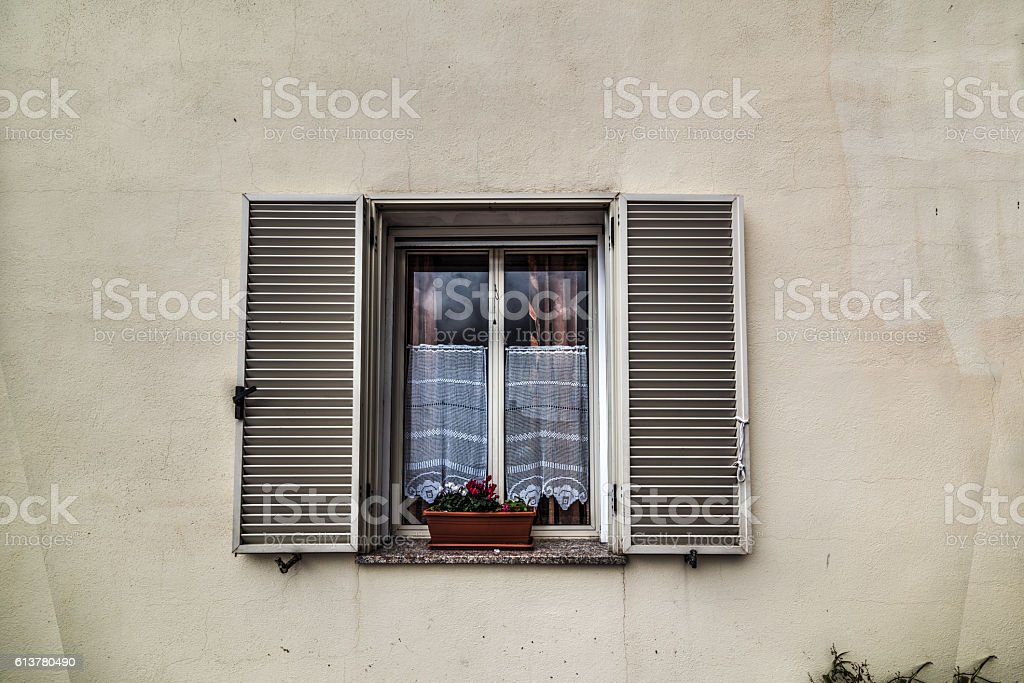 Rustic wall with open window stock photo