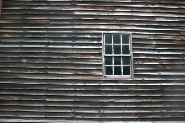 Rustic wall with window at right side stock photo