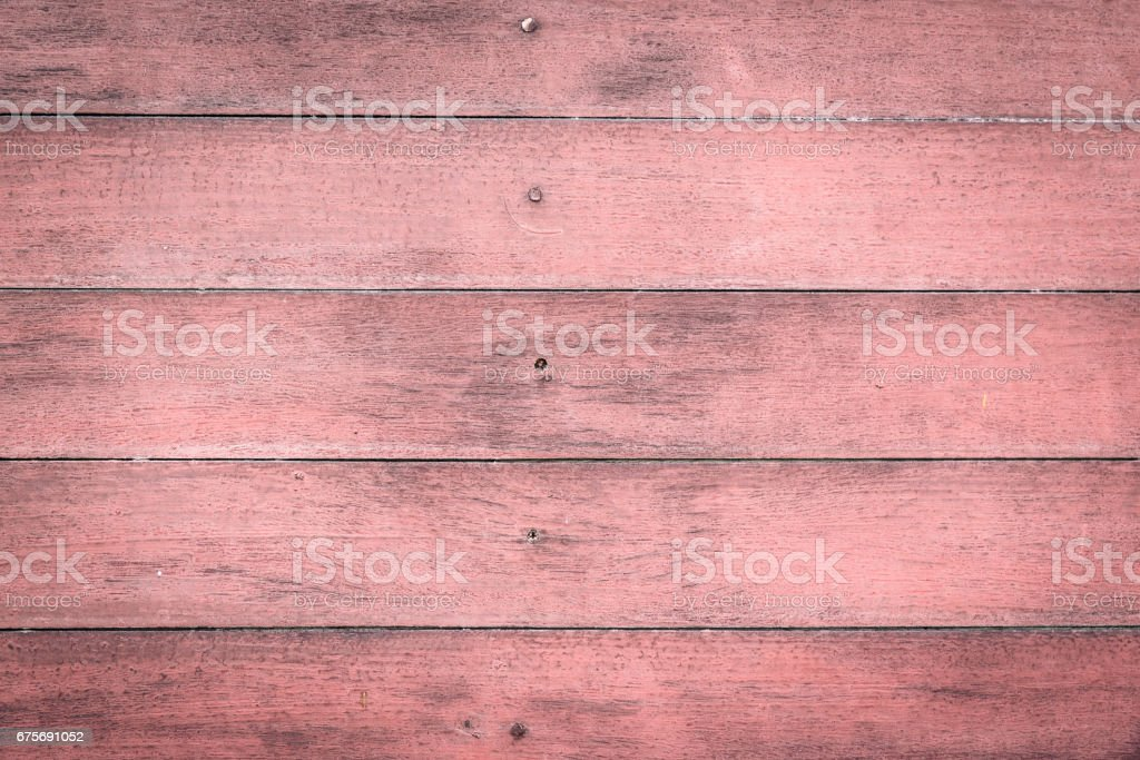 rustic weathered barn old pink wood background with knots and nail holes. royalty-free stock photo