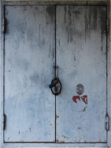 rustic weathered metal door shutters