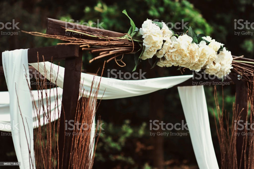 Rustic Wedding Decoration With Flowers And Branches In A Mason Jar Ceremony