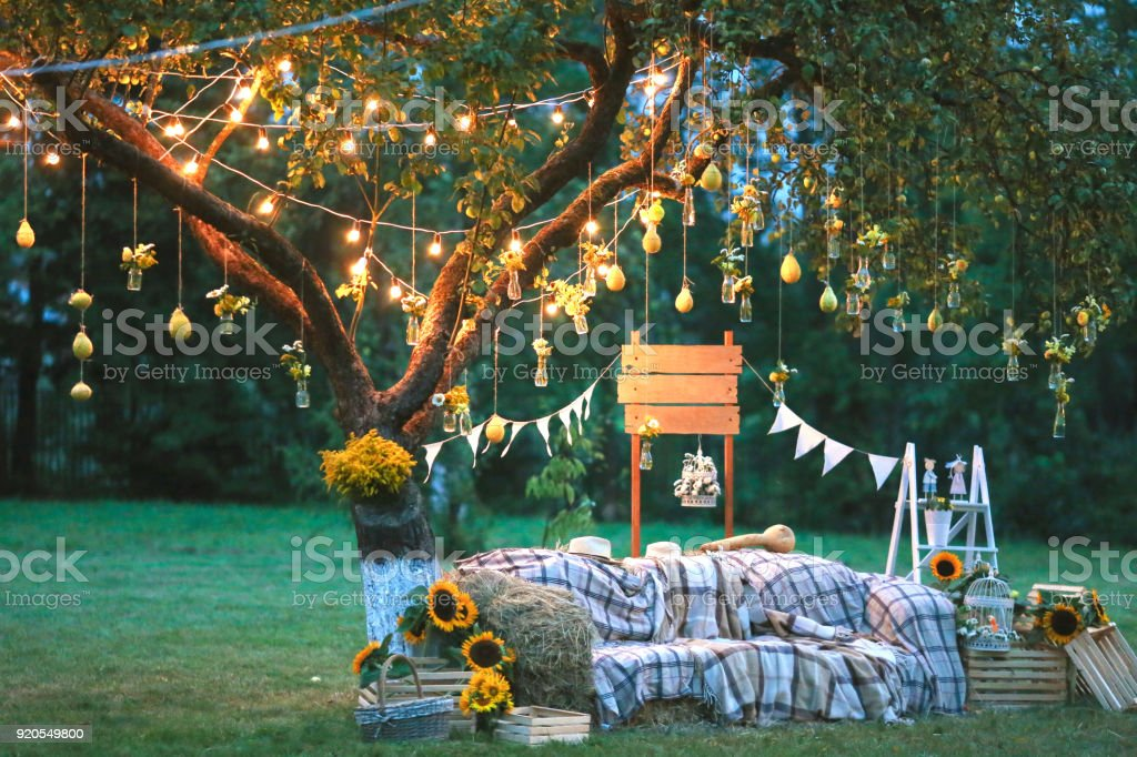 Rustic Wedding Decorations.Rustic Wedding Photo Zone Hand Made Wedding Decorations Includes Photo Booth Wooden Barrels And Boxes Lanterns Suitcases And White Flowers Stock Photo