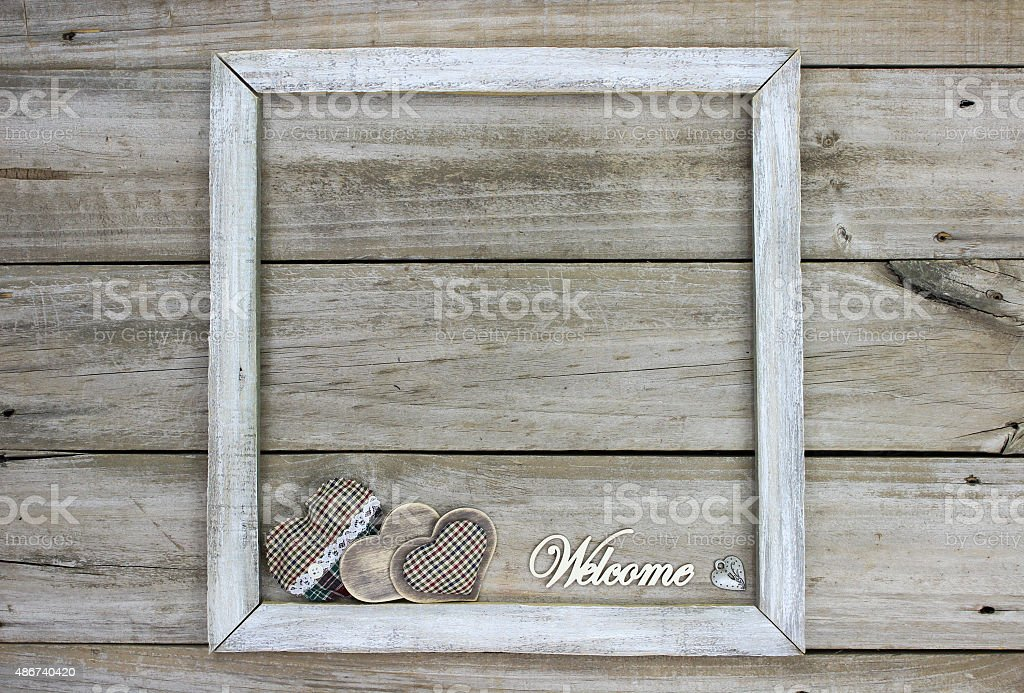 Rustic welcome sign with hearts stock photo