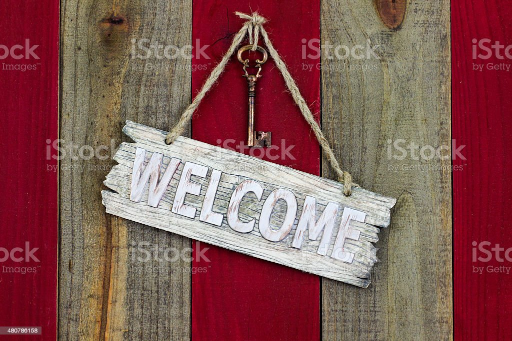 Rustic welcome sign with skeleton key stock photo