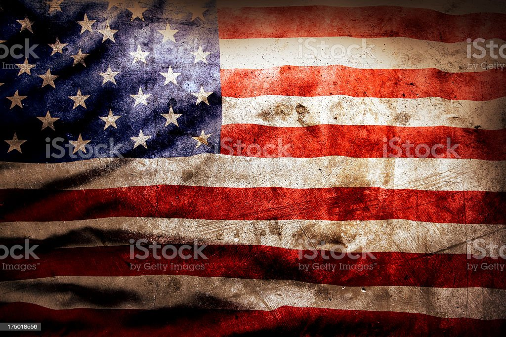Rustic, well-worn American flag stock photo