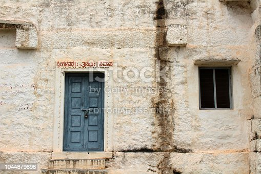 A rustic window and a door at an ashram complex in Hampi. Taken in India, August 2018.