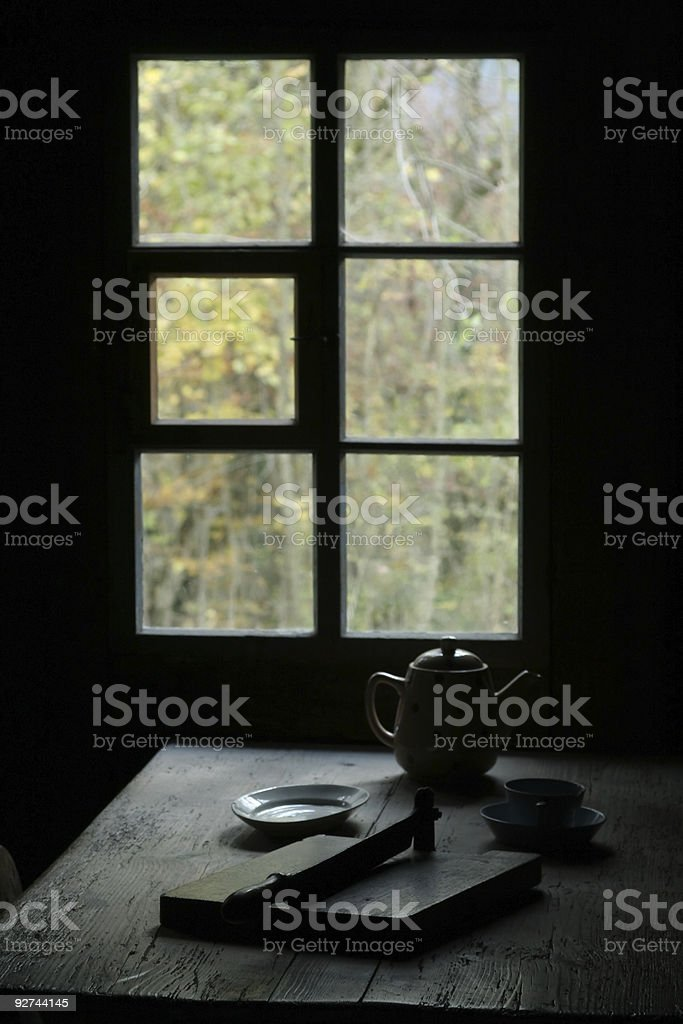 Rustic Window Antique Dining Table stock photo