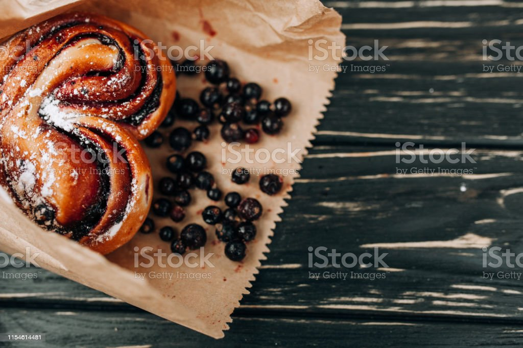 Rustic with black current berry filling pie on black wooden table...