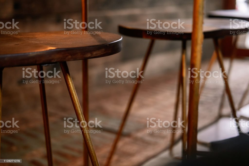 Sensational Rustic Wood And Bronze Metal Bar Stool Stock Photo Ocoug Best Dining Table And Chair Ideas Images Ocougorg