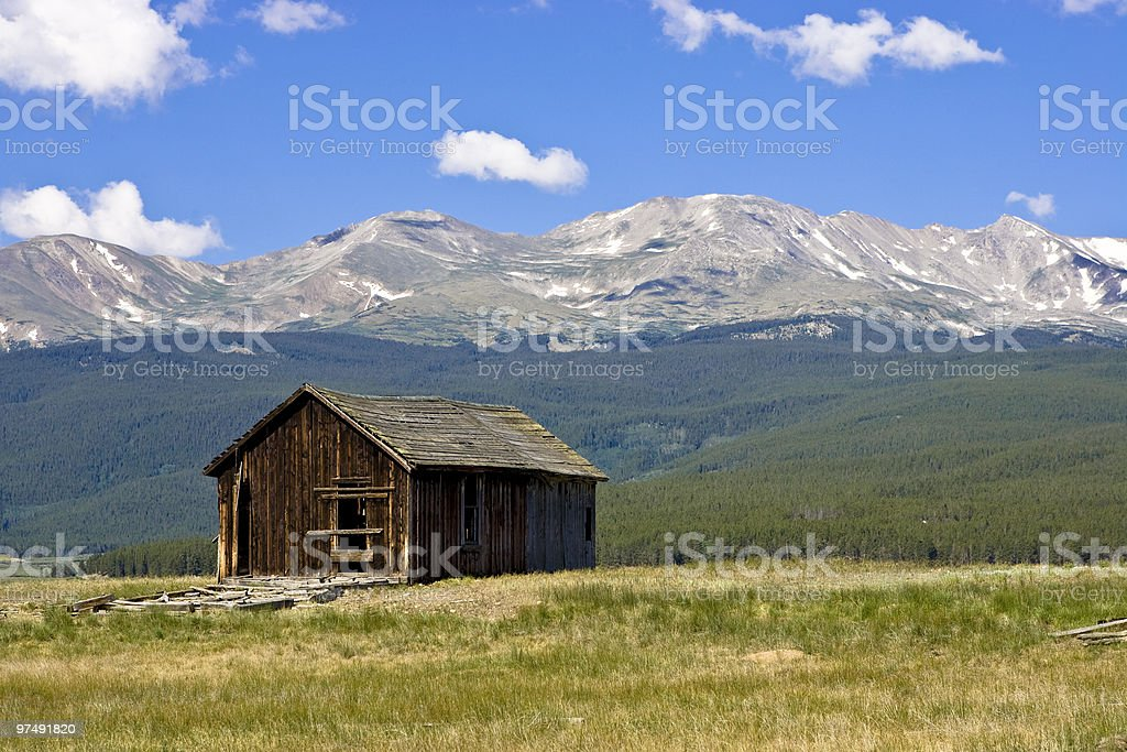 Rustic Wood Homestead at Mountain Base royalty-free stock photo