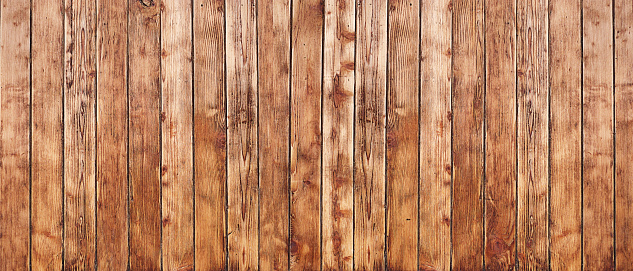 A long full frame of weathered wood-grain boards.
