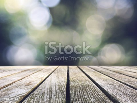 989111446istockphoto Rustic Wood Picnic Table Top Over Cool Nature Blurred Bokeh Background 926425144