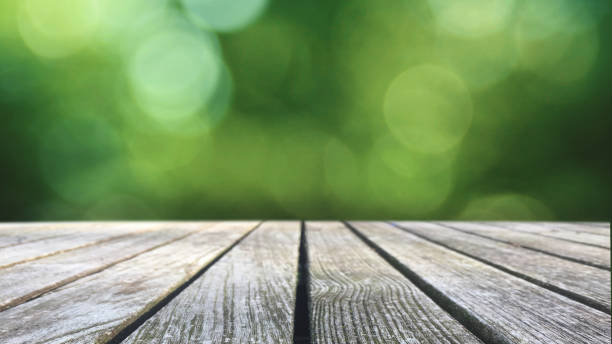 Rustic Wood Table Over Green Blurred Background stock photo