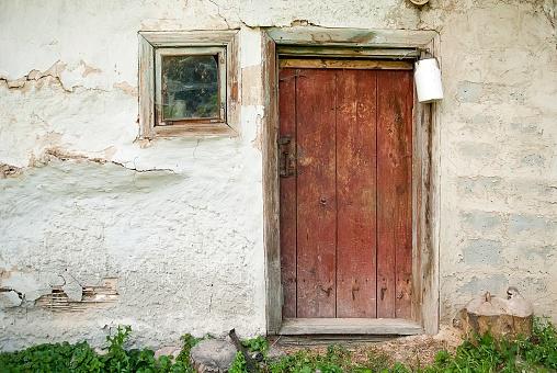 Rustic wooden barn door with white milk can