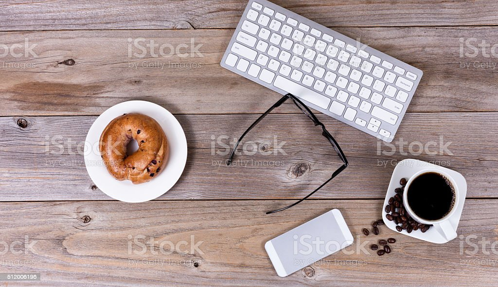 Rustic wooden desktop with morning food and drink stock photo