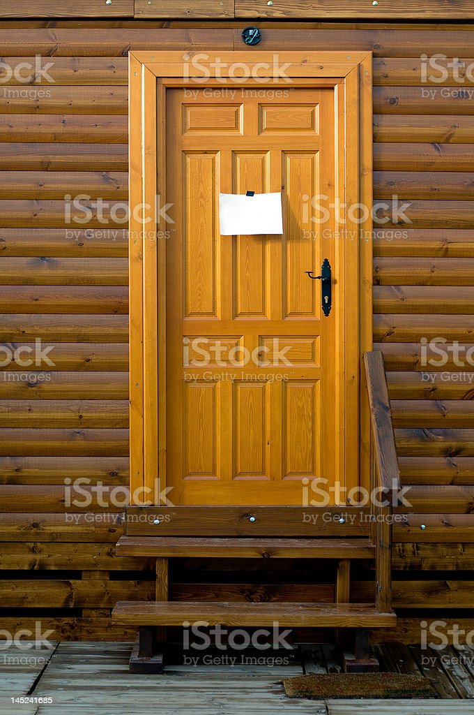Rustic wooden door with a sign blank royalty-free stock photo