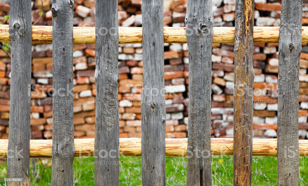 Rustic wooden fence with a cabin beyond stock photo