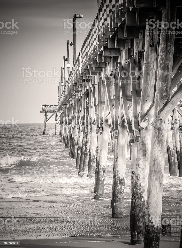 Rustic Wooden Recreational Saltwater Fishing Pier in Sepia BW stock photo