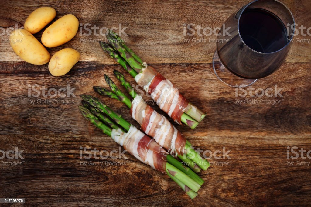 Rustic wooden table with glass of wine stock photo