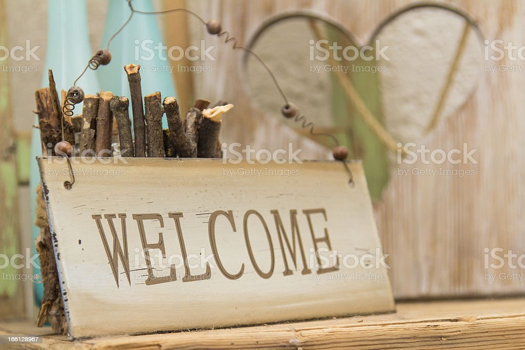 Rustic wooden WELCOME sign stock photo