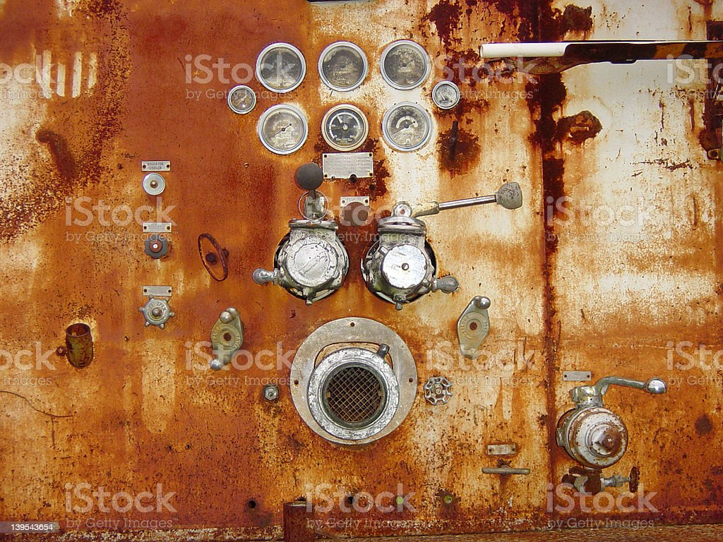 Rusting Metal With Gauges And Hose Connections royalty-free stock photo