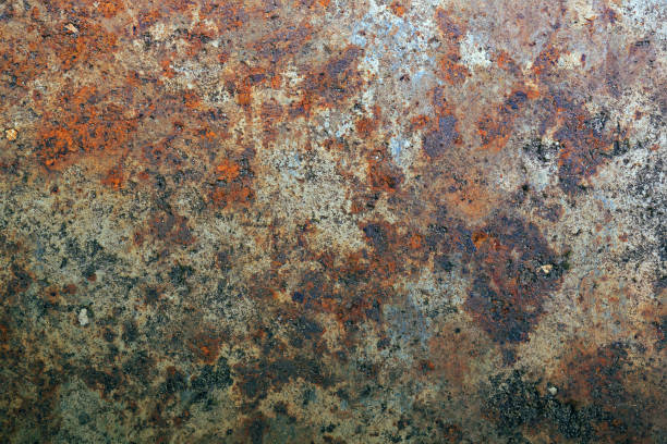 Rusting on the surface of old iron, steel destruction, decay and grunge textured background stock photo