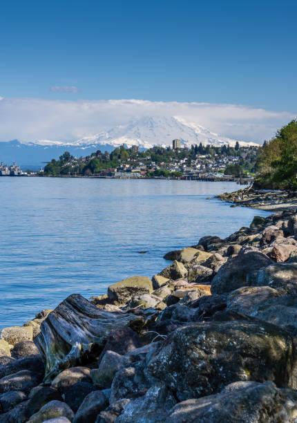 Ruston Shoreline And Mountain 4 Majestic Mount Rainier towers over the Ruston shoreline near Tacoma, Washington. tacoma stock pictures, royalty-free photos & images