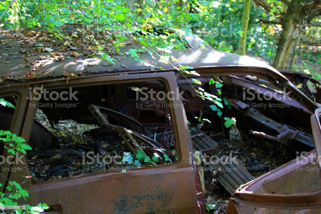 A Rusty Abandoned Car In Woods Essex England Stock Photo More