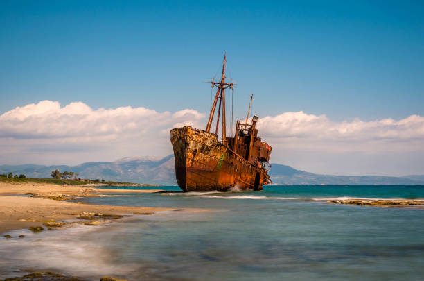 Rusty and abandoned shipwreck stands on a coastline near Gythio in Lakonia. stock photo