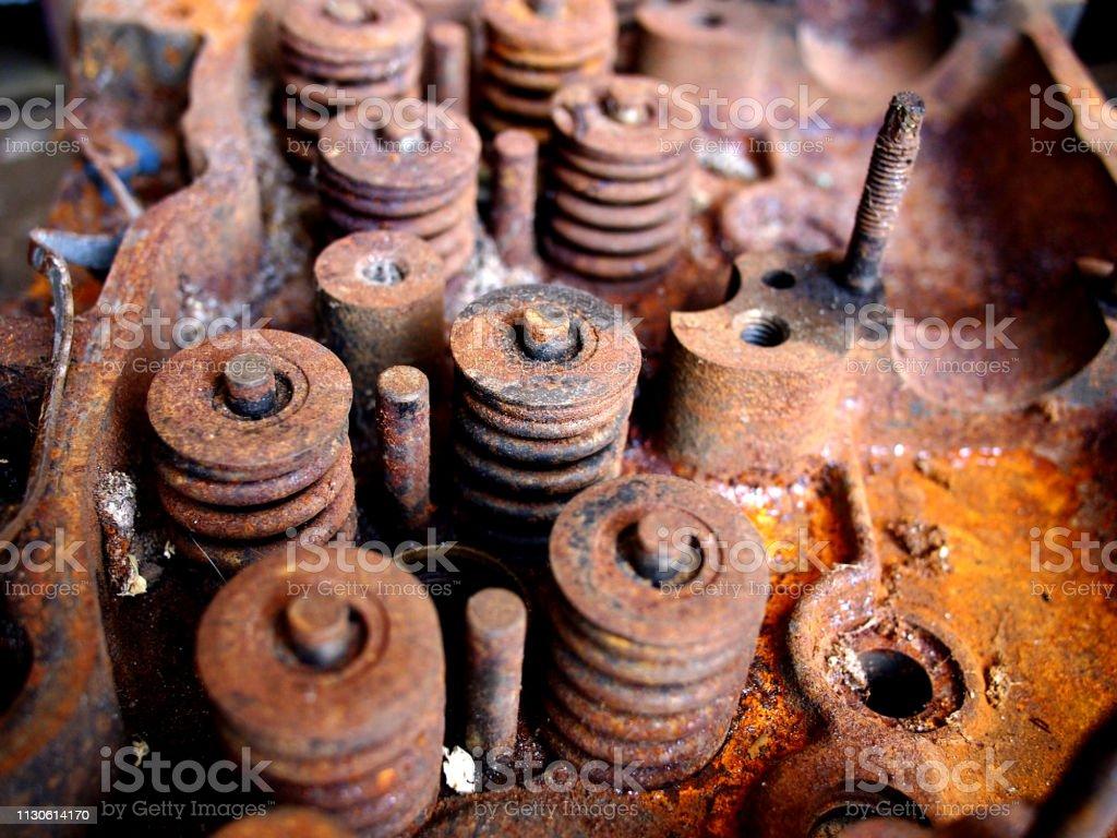 Rusty and broken car engine at a junkyard stock photo