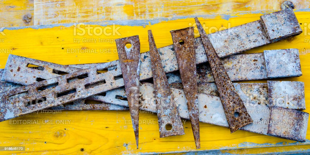 rusty and dirty iron wedges used on a construction site stock photo