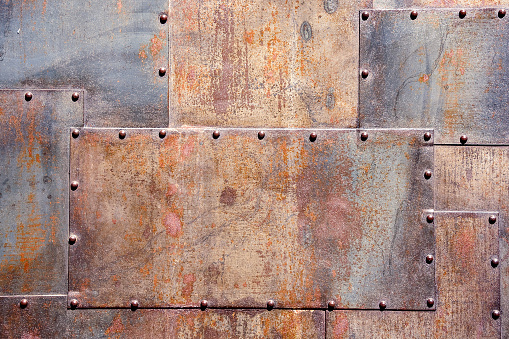 rusty and scratched metal panel background