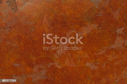 istock Rusty background with stains and scratches 892077034