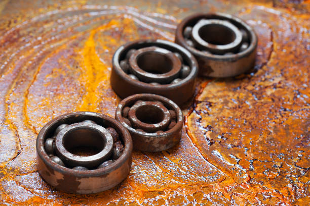 Rusty ball bearing with the rusty background. stock photo