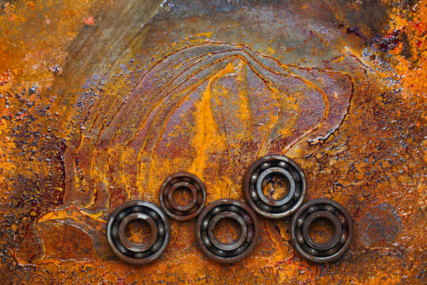 Rusty ball bearing with the rusty background. Top view. stock photo