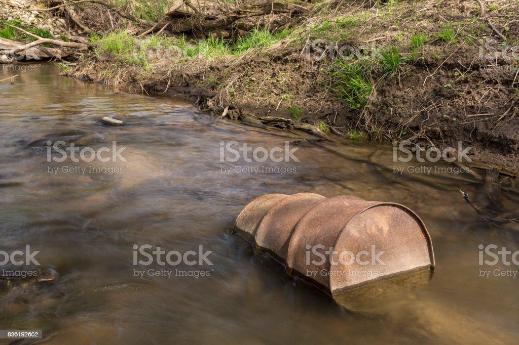 Rusty Barrel In Creek stock photo