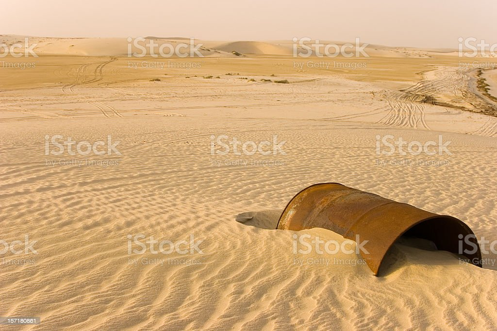 Rusty barrel in the desert stock photo