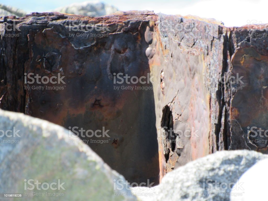 Rusty Barrier in Jetty stock photo