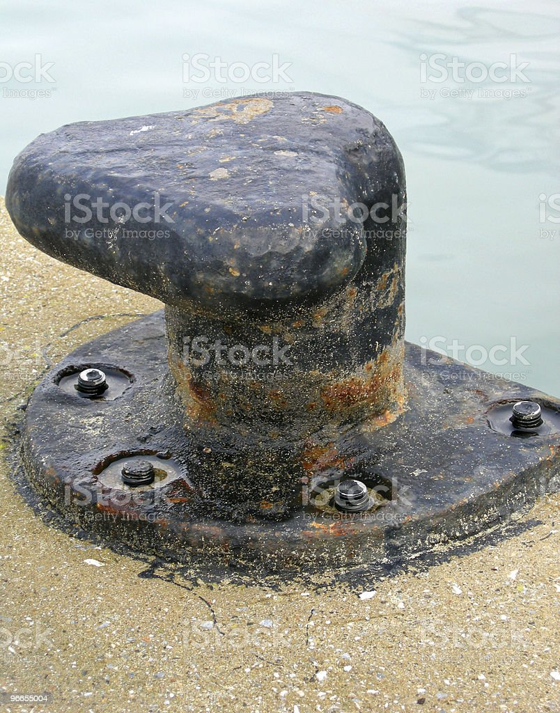 Rusty bitt on a boat dock royalty-free stock photo