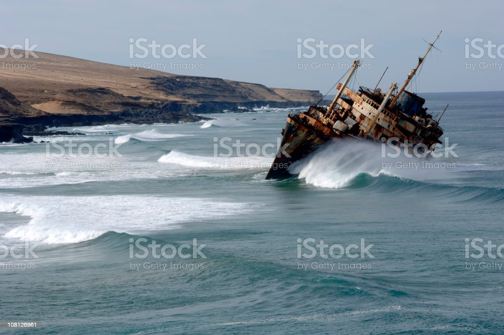 Rusty Boat Capsizing Near Canary Island Coastline stock photo