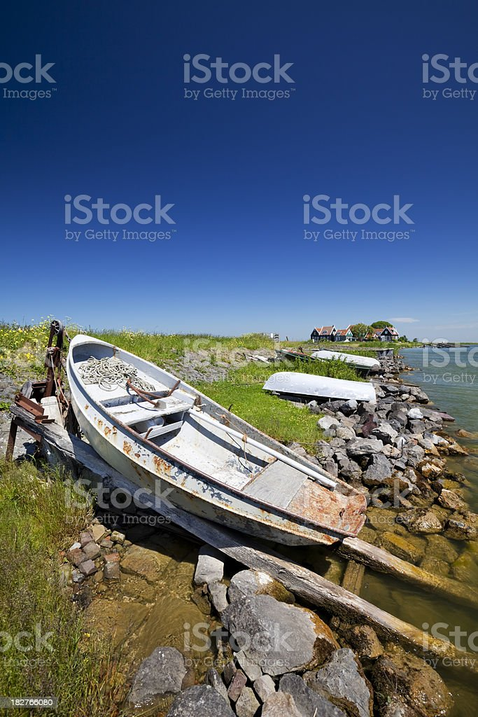 Rusty boats lying on the shore of Marken, The Netherlands royalty-free stock photo