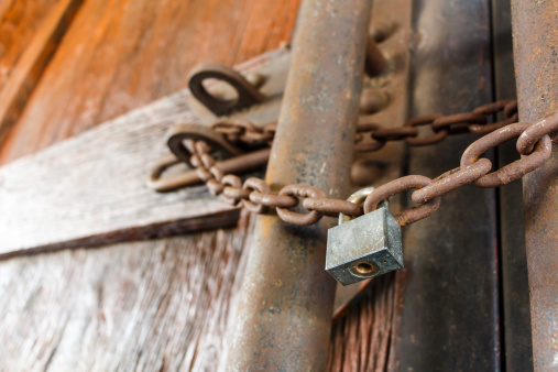 istock rusty chain and master key 468269697