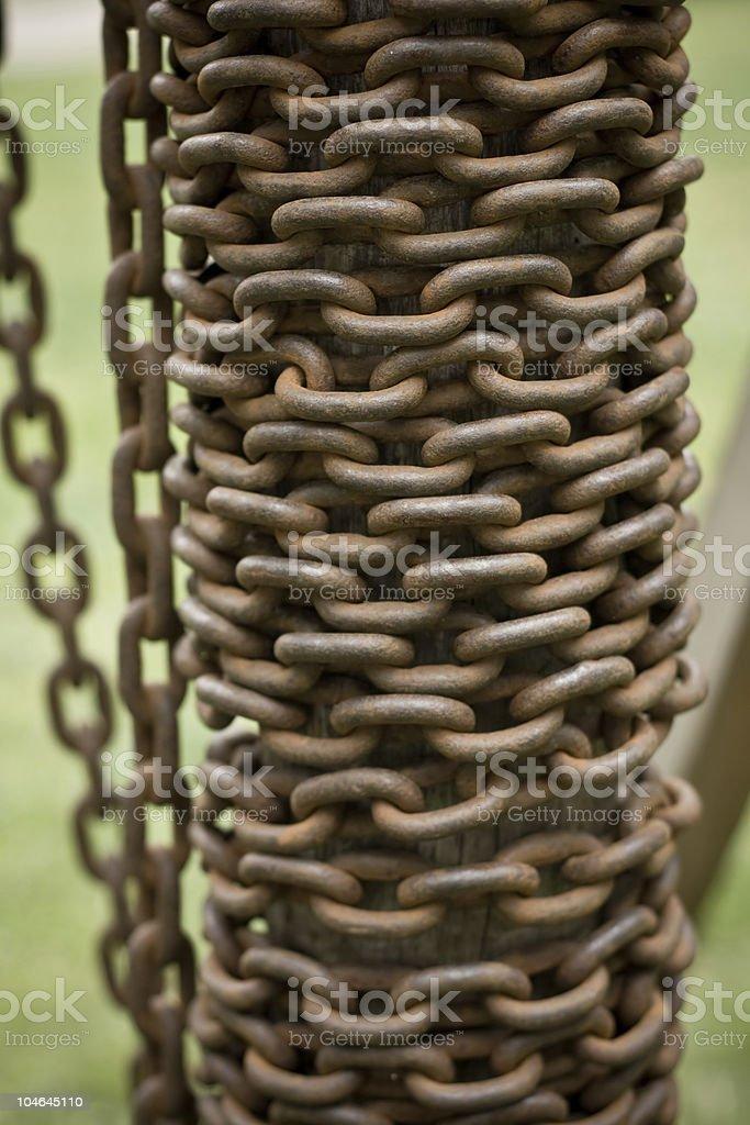 Rusty chain on a bole royalty-free stock photo