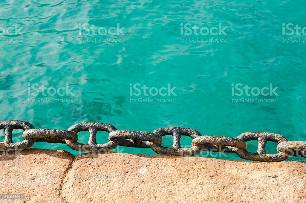 rusty chain on a dock stock photo