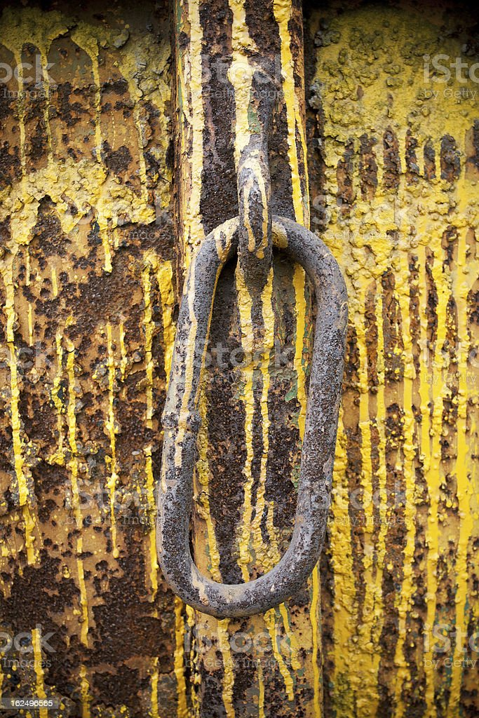 Rusty chain over painted background royalty-free stock photo