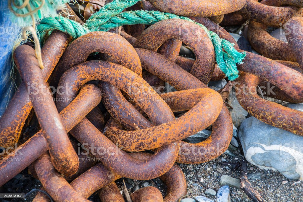 Rusty Chains on a beach stock photo
