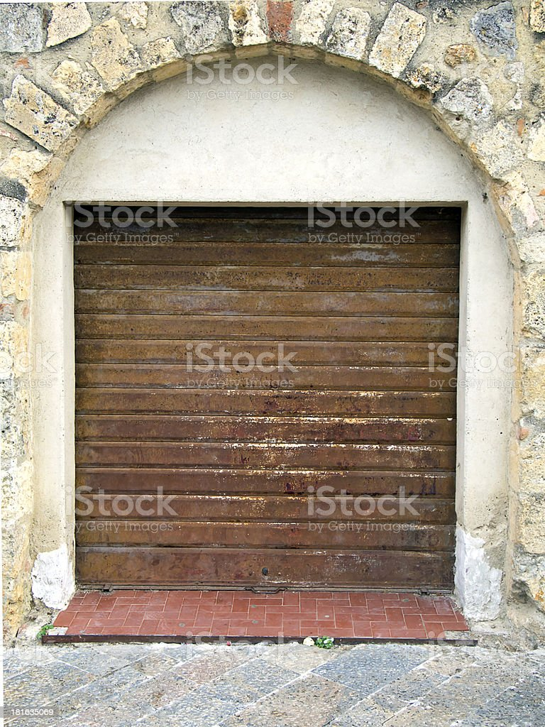rusty  closed rolling portcullis  of shop royalty-free stock photo