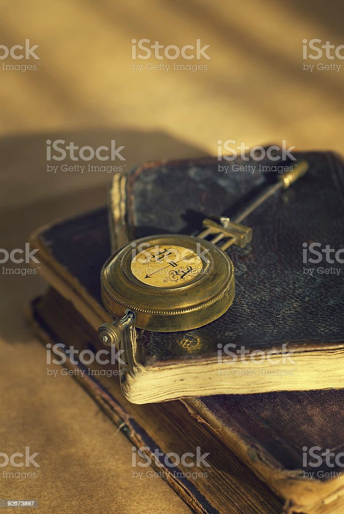 Rusty Compass and Old Book stock photo